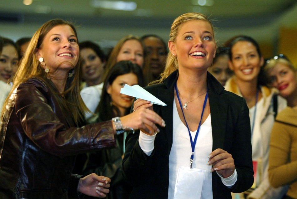 Imogen Thomas, left, pictured in 2003 at the Miss World beauty pageant in Shanghai