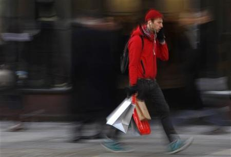 A shopper walks down a street in London