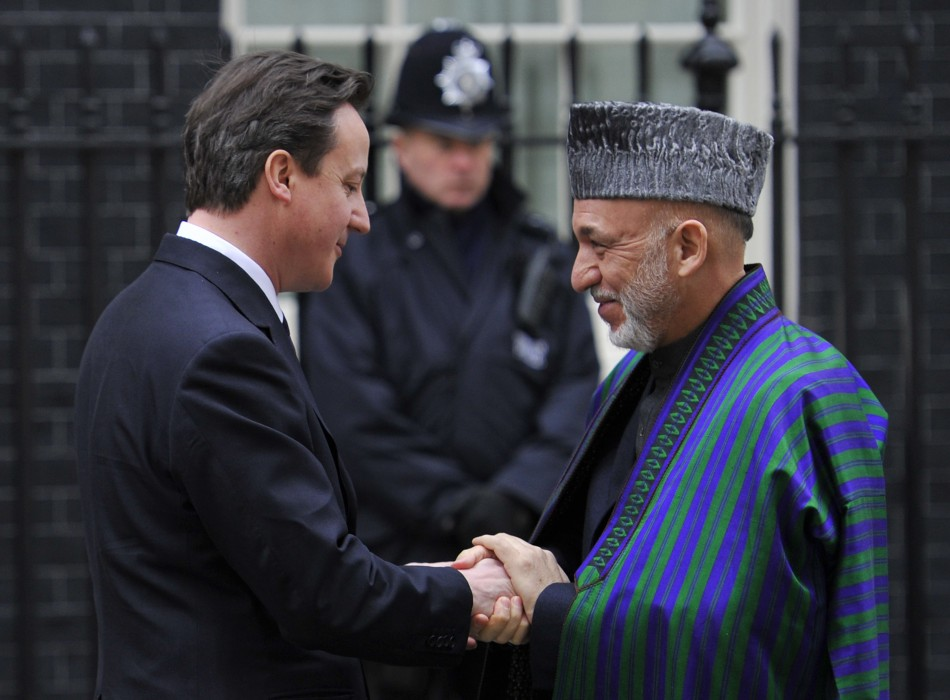 Britain's Prime Minister Cameron greets Afghanistan's President Karzai outside Downing Street in central London