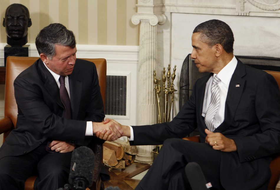 U.S. President Barack Obama shakes hands with Jordan's King Abdullah after a private meeting in Washington
