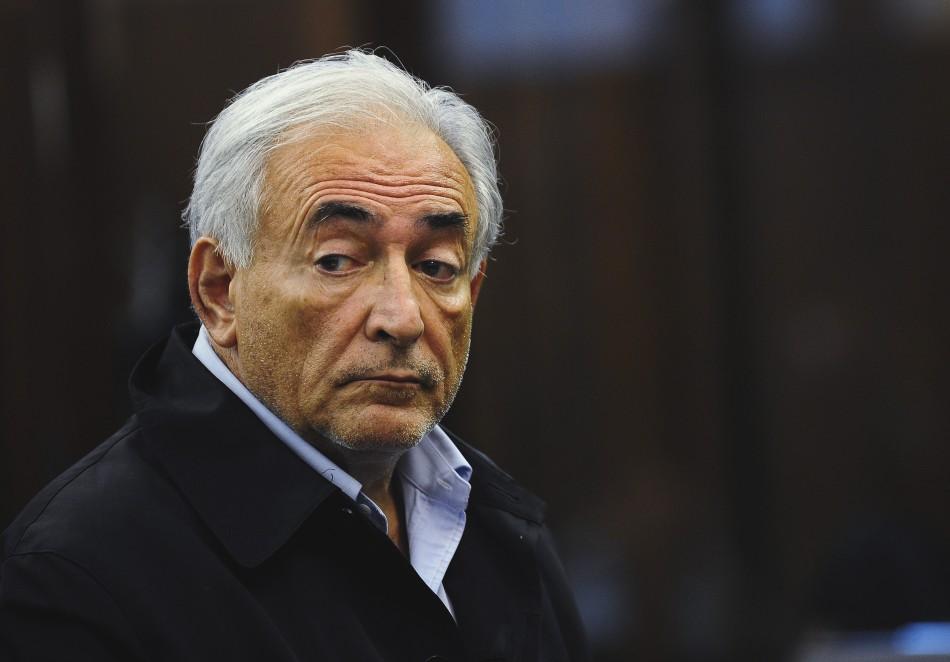 IMF chief Dominique Strauss-Kahn listens during his arraignment in Manhattan Criminal Court in New York