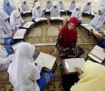 "Muslim schoolgirls recite verses from the Quran on the occasion of ""Nuzul Al-Quran"""