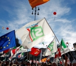 Supporters wave flags during a rally led by Italian PM Renzi