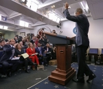 Obama waves at his last press conference