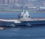China's ministry 'sincerely sorry' after internet mocks badly photoshoped picture of aircraft carrier