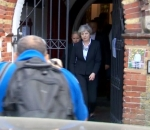 Theresa May Hastily Leaves Refuge Center To Escape Angry Crowd