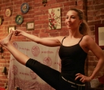 """Yoga instructor Dilek Edwards has been cleared by a Manhattan court to pursue her claim that she was fired for being """"too cute"""""""