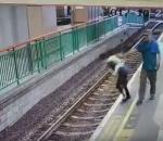 Man pushes woman on rail tracks HongKong