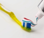 Toothbrush topped with toothpaste